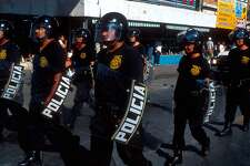394003 01: Mexican police march September 16, 1999 in downtown Nuevo Laredo, Mexico during Independence Day celebrations. (Photo by Per-Anders Pettersson/Getty Images)