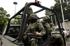 "Mexican Navy marines patrol in a truck the surroundings of the Deputy Attorney Specialized in Investigation of Organized Crime (SEIDO) headquarters, where the alleged maximun leader of drugs Mexican cartel ""Los Zetas"" Miguel Angel Trevino Morales, aka ""Z 40"", remains under investigation, in Mexico City on July 16, 2013. Trevino's arrest early Monday by Mexican Navy near Nuevo Laredo (Tamaulipas, northeast), bordering the United States, is the most significant blow against drug trafficking by Enrique Pena Nieto government who took office last December.   AFP PHOTO / Yuri CORTEZ        (Photo credit should read YURI CORTEZ/AFP/Getty Images)"