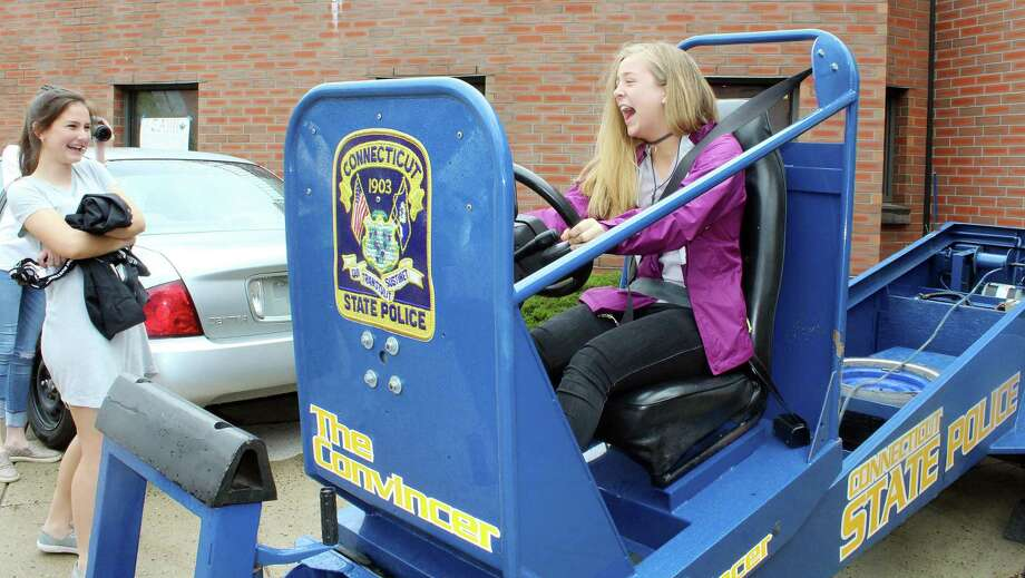 "A student at last month's Traffic Safety Fair at Darien High School felt the effects of a simulated car crash on ""The Convincer"" on April 27, 2017 in Darien, CT. Photo: Erin Kayata / Hearst Connecticut Media / Darien News"