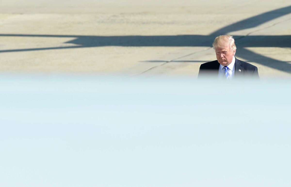 President Donald Trump walks up the steps of Air Force One at Andrews Air Force Base in Md., Wednesday, May 17, 2017. Trump is heading to the U.S. Coast Guard Academy in New London, Ct., where he will give the commencement address.