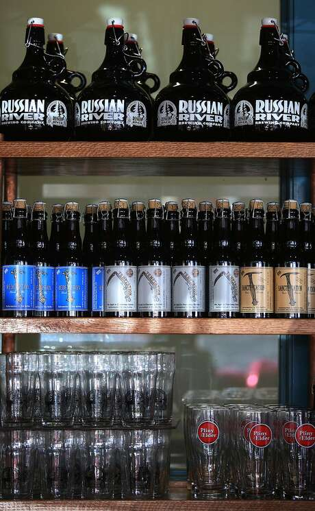 Bottles of beer, glasses, and growlers displayed at the Russian River Brewing Company brewpub in Santa Rosa. Photo: Liz Hafalia, The Chronicle