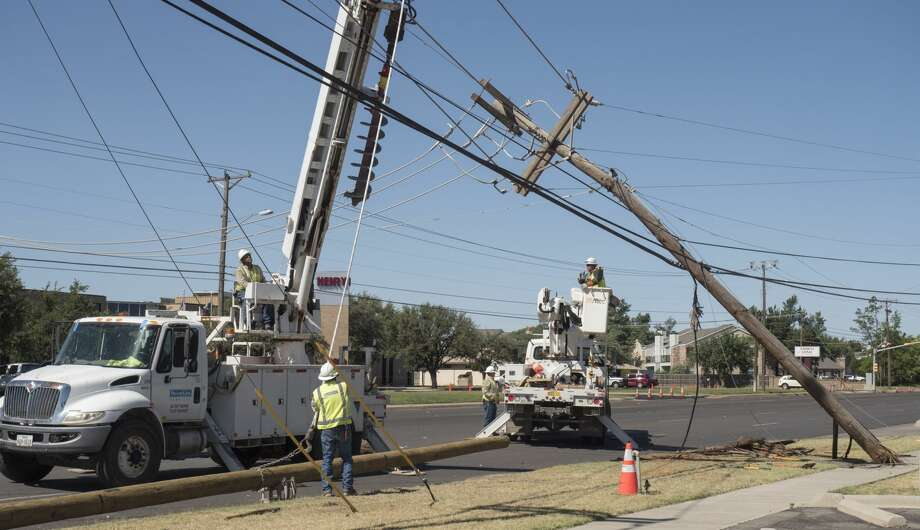 """Crews continue to work 5/17/17 to replace an electrical pole following a crash Tuesday night wherean MPDcruiser lost control and struck the pole during a""""high-priority"""" call. Tim Fischer/Reporter-Telegram Photo: Tim Fischer/Midland Reporter-Telegram"""