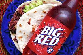 Taco of the Week: Big Red and barbacoa special — a barbacoa taco with guacamole on a handmade flour tortilla with a 20-ounce Big Red — from Tommy's Restaurant.