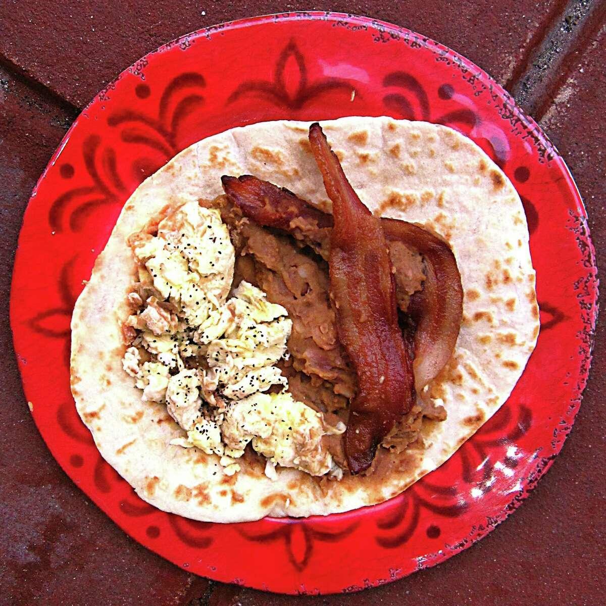 Bacon, egg and bean taco on a handmade flour tortilla from Eddie's Taco House.