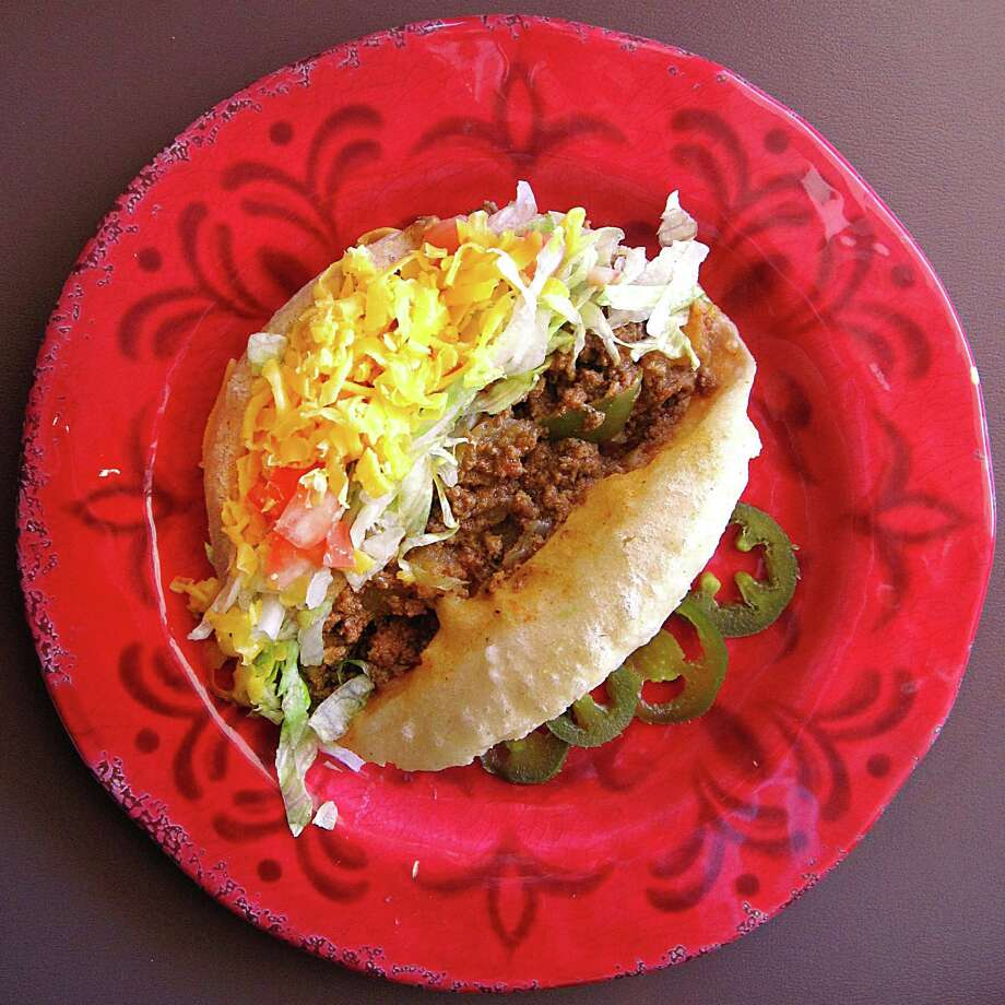 Beef puffy taco from Patsy's Place on West Avenue in San Antonio. Photo: Mike Sutter /San Antonio Express-News