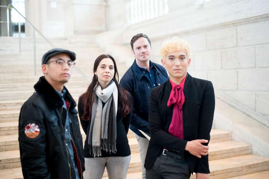 Jeremy Keith Villaluz (left), Shiva Ahmadi, curator Marc Mayer and Ryan Tacata of the Asian Art Museum's Artists Drawing Club, which is dealing with more topical issues in its fifth year. Photo: Noah Berger, Special To The Chronicle