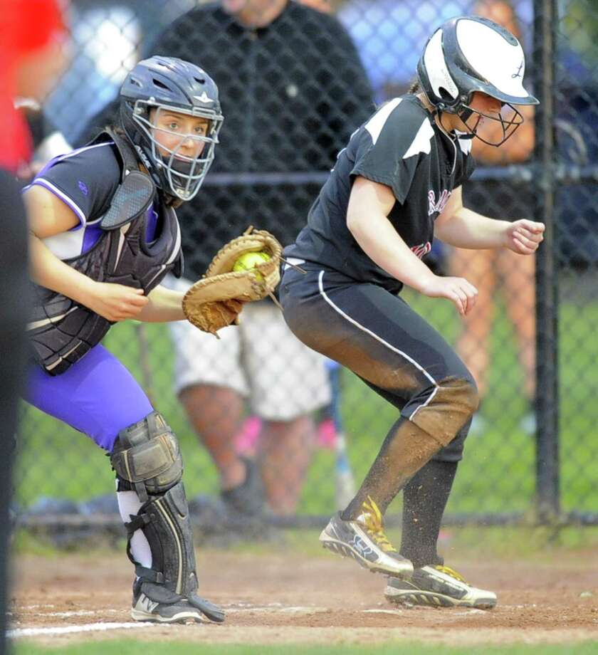 New Canaan Rachel Keshin slides past the tag of Westhill Jordan Benzaken in a varsity girls softball game at Waveny Park in New Canaan on May 16, 2017. Westhill won 3-2. Photo: Matthew Brown / Hearst Connecticut Media / Stamford Advocate