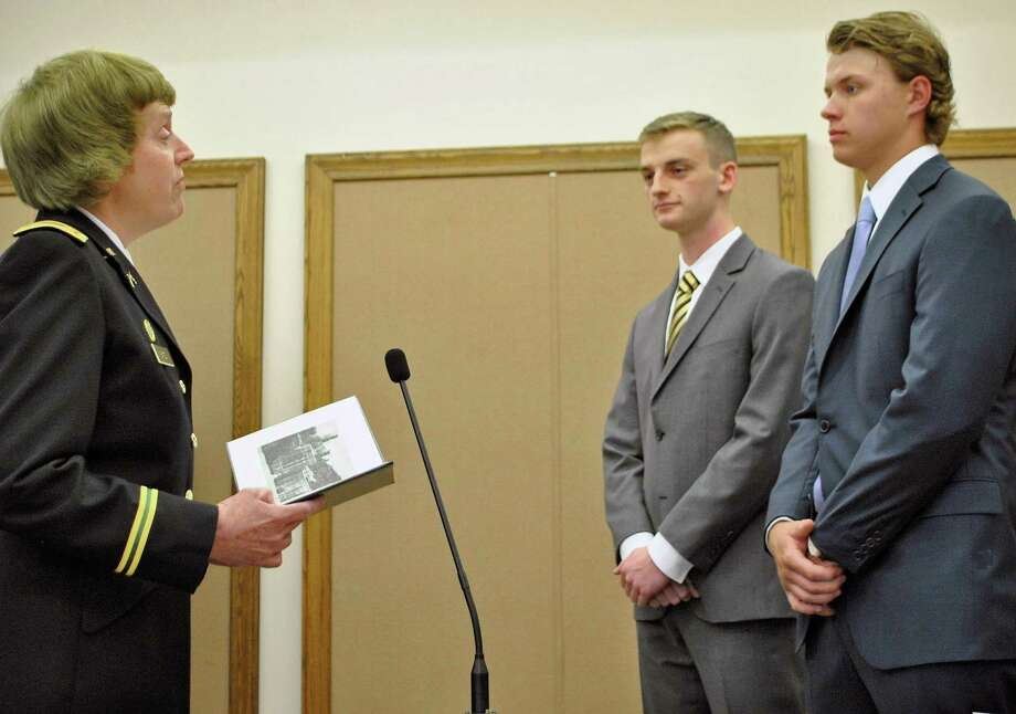 Maj. Nancy Bates (left) presents West Point Academy appointments to Joseph Waldron and Michael Halas. Photo: / Submitted Photo