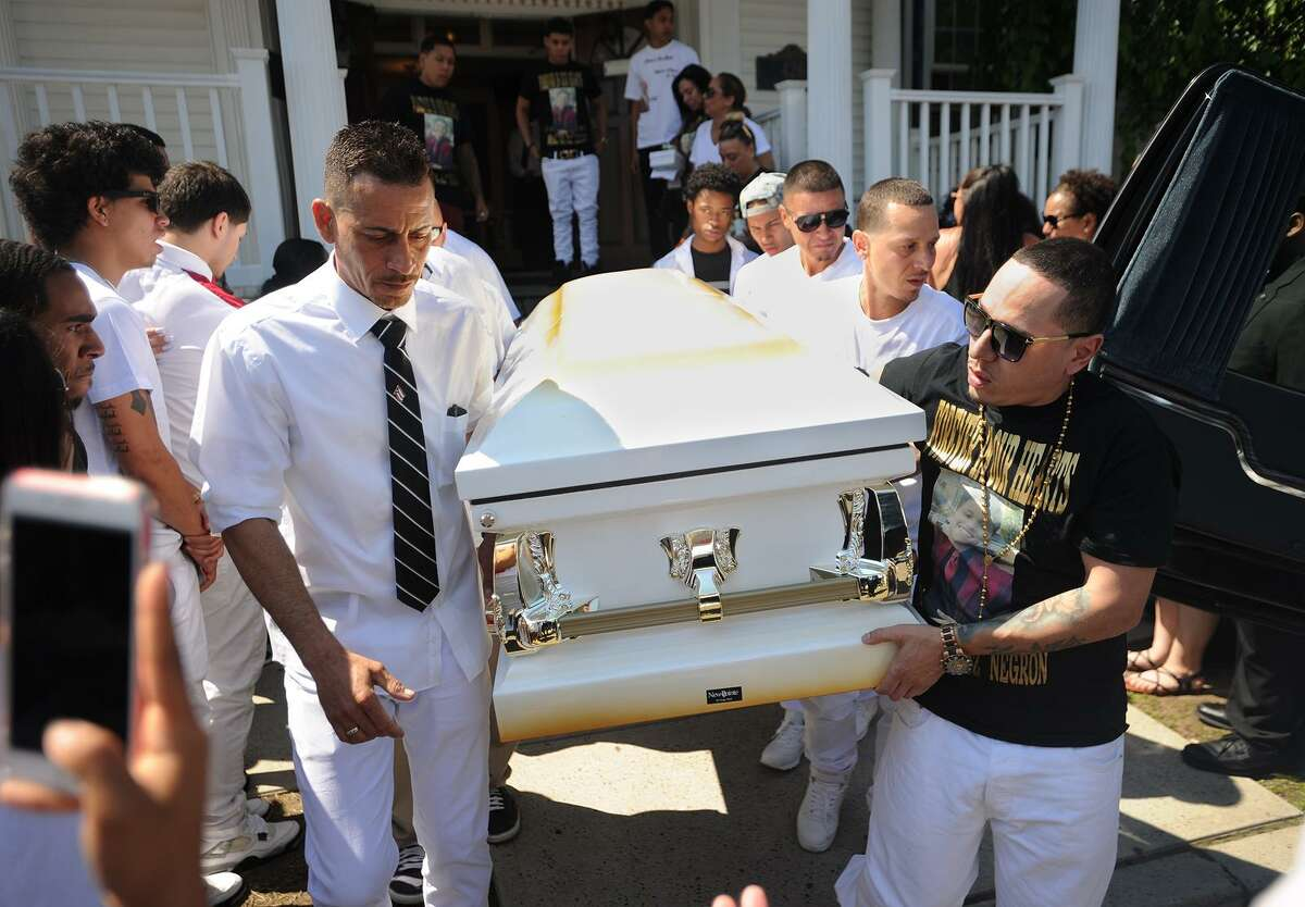 The casket of 15-year-old Jayson Negron is carried to a waiting hearse following his funeral service at Funeraria Luz de Paz at 426 East Washington Avenue in Bridgeport, Conn. on Wednesday, May 17, 2017.