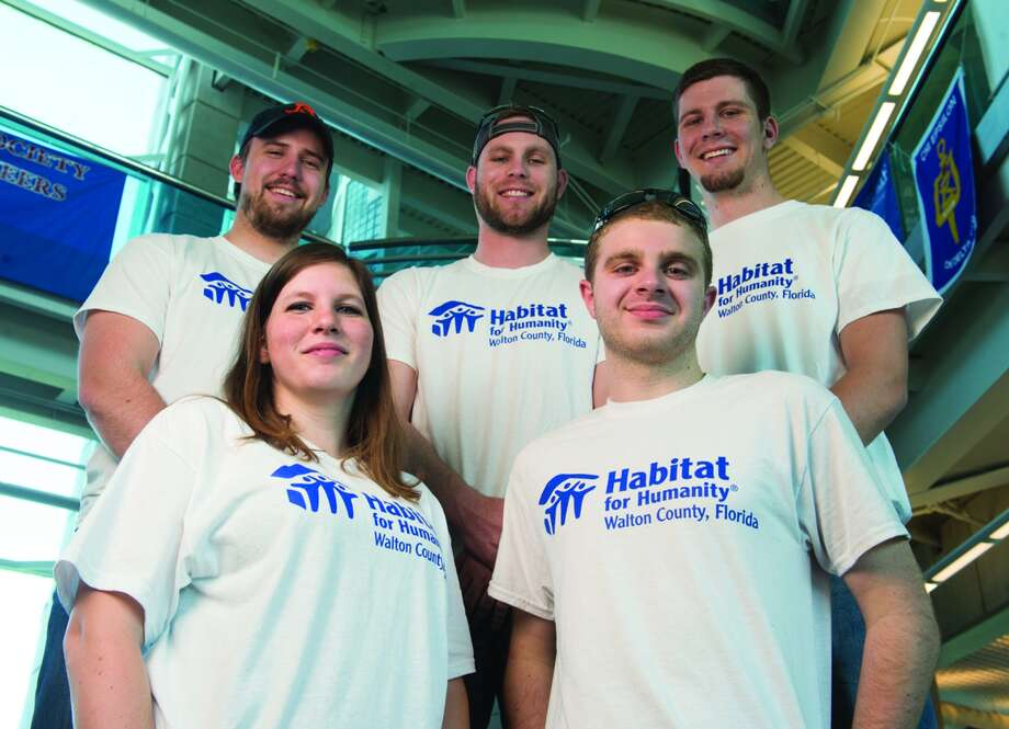 Six members of the SIUE School of Engineering's Constructor's Club spent spring break in Florida, helping build homes with Habitat for Humanity. Participating students included (front) Nicole Howell, of Vienna, Dalton Brookshire, of Nokomis, (back L-R) Aaron Borrowman, of Rockport, Will Zerr, of St. Peters, Mo., and Jordan Grant, of East Peoria. Alex Orban, of Streator, is not pictured. Photo: For The Intelligencer