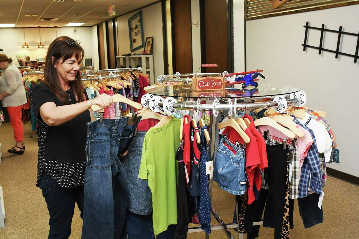 Volunteer Barbara Pierce helps in the children section of the Hope Chest. The organization opened its first re-sale shop, The Hope Chest, in September 2016. Acceptable resale items for the shop include clothes, books, working appliances, tools, lawn equipment, and retail donations. The Hope Chest serves and helps the Cy-Fair and northwest Houston community.