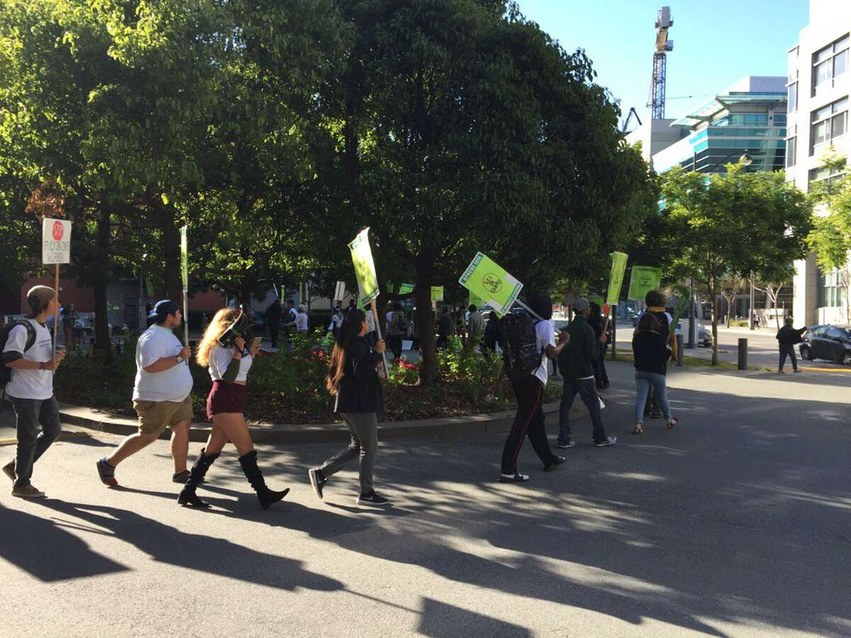Protesters briefly shut down a UC regents meeting at UCSF Mission Bay on Wednesday May 17, 2017. They were protesting tuition increases while the president's office kept on hand $175 million in secret funds.