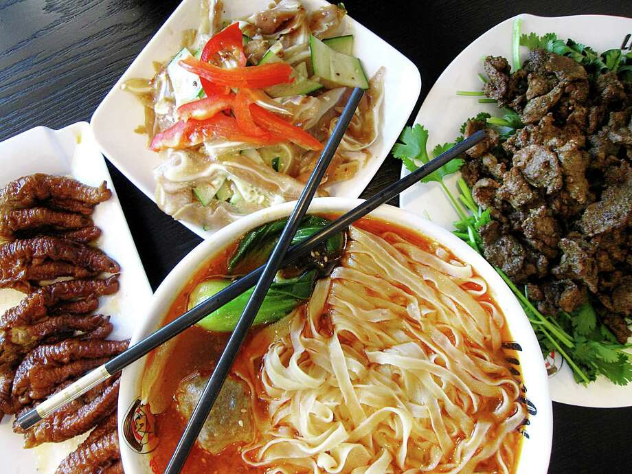 Marinated chicken feet, left, marinated pig's ear, fried lamb with cumin and mala tang soup with bok choy and meatballs from Lucky Noodle. Photo: Mike Sutter /San Antonio Express-News