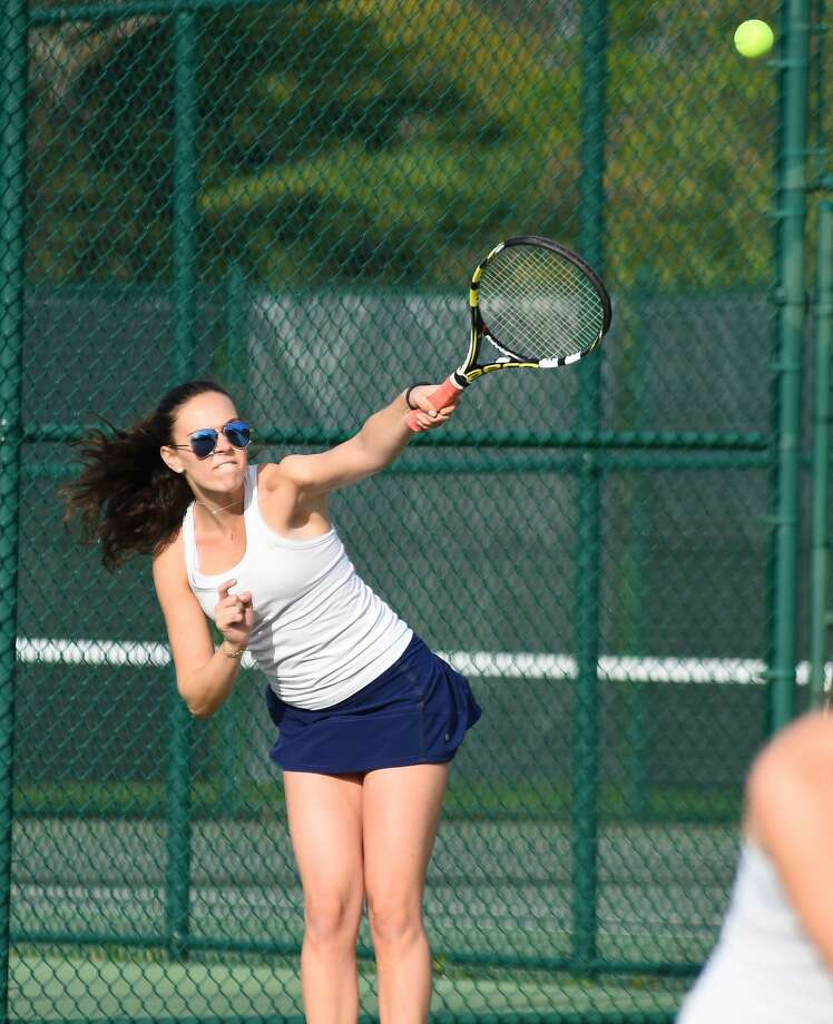 Seniors Blaire Marine of Darien (left) won 8-3 in her doubles match against Master's School on Friday, May 12. Photo: Contributed Photo / Darien News contributed