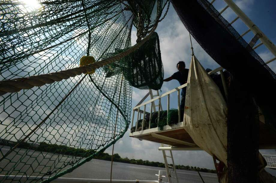 Shrimpers in Port Arthur change out nets Friday morning to switch from shrimping in Texas waters to Louisiana waters. The industry is finding younger generations of workers uninterested in getting into the shrimping business.   Photo taken Friday May 12, 2017 Guiseppe Barranco/The Enterprise Photo: Guiseppe Barranco, Photo Editor