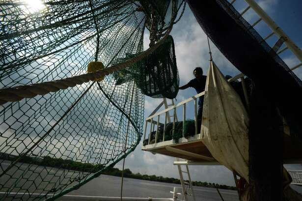 Shrimpers in Port Arthur change out nets Friday morning to switch from shrimping in Texas waters to Louisiana waters. The industry is finding younger generations of workers uninterested in getting into the shrimping business.   Photo taken Friday May 12, 2017 Guiseppe Barranco/The Enterprise