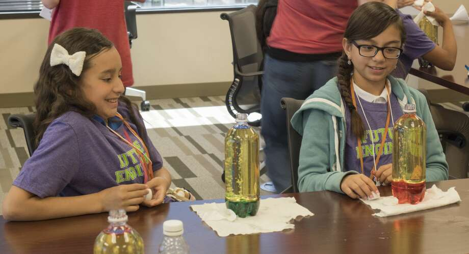 Kaitlyn Cruz and Yvana Garcia react as they watch their home-made lava lamps 5/17/17 at XTO Energy during a girls in engineering program. Tim Fischer/Reporter-Telegram Photo: Tim Fischer/Midland Reporter-Telegram
