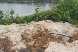 An estimated 20 to 40 gallons of oil leaked into the San Jacinto River after the line of a non-producing well was accidentally nicked Wednesday, May 17 in Forest Cove.
