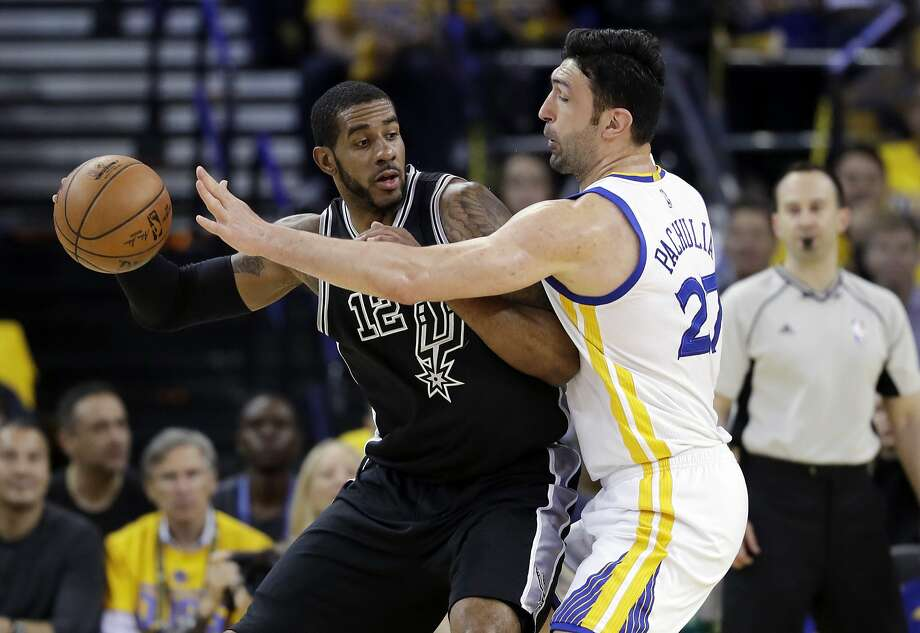 San Antonio Spurs' LaMarcus Aldridge (12) is defended by Golden State Warriors' Zaza Pachulia (27) during the first half of Game 2 of the NBA basketball Western Conference finals, Tuesday, May 16, 2017, in Oakland, Calif. (AP Photo/Marcio Jose Sanchez) Photo: Marcio Jose Sanchez, Associated Press