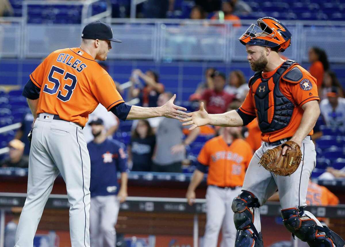 Houston Astros relief pitcher Ken Giles (53) and catcher Evan Gattis celebrate after the Astros defeated the Miami Marlins 3-0 in a baseball game, Wednesday, May 17, 2017, in Miami. (AP Photo/Wilfredo Lee)