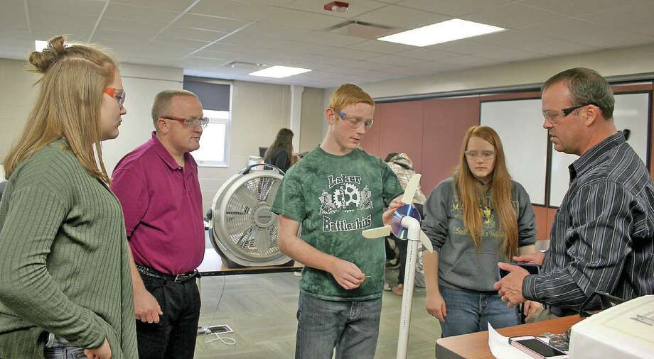 From the left, Kennedy Bouck, science teacher Scott Lebsack, Aaron Baranski and Kylie Chubb work with Nathan Elder, of Delta College, to test the student team's turbine blades they designed using a computer-aided design (CAD) program called Solid Works. Photo: Submitted Photos