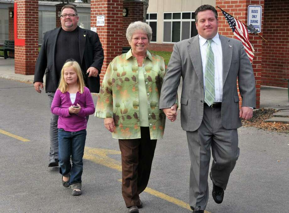 Unopposed candidate for Albany County Executive, Dan McCoy, at right, leaves the Academy of the Holy Names in Albany after voting with family members, brother Brian McCoy, left, daughter Taryn McCoy ,7, and his mother Marie McCoy on Tuesday, Nov. 8, 2011, in Albany, N.Y.  McCoy's brother Brian has a job in the county sheriff's department. The county executive said he has not helped his relatives get jobs. (John Carl D'Annibale / Times Union) Photo: John Carl D'Annibale / 00015302A