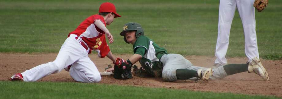 New Milford's Nick Scarcella slides head on to second to get an extra base at the bottom of the third during the May 9 game. Photo: Courtesy Of Katie Alzapiedi / The News-Times Contributed