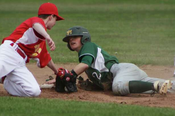 New Milford's Nick Scarcella slides head on to second to get an extra base at the bottom of the third during the May 9 game.