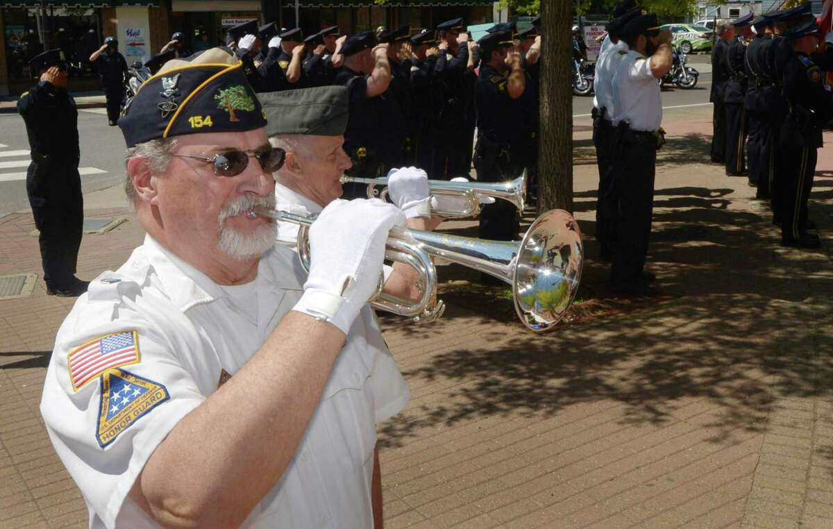 Jon Worley and Fred Miodowski play taps as Norwalk police and other local departments take part in the annual police memorial service at police headquarters in honor of National Police Week Wednesday, May 17, 2017, in Norwalk, Conn.