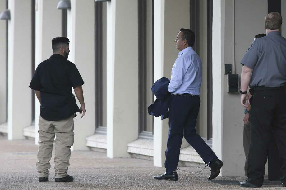 Federal marshals lead Texas State Sen. Carlos Uresti, 53, from the Federal Building to the Federal Courthouse, Wednesday, May 17, 2017. He appeared in court after being indicted Tuesday on 13 federal counts for bribery and fraud in two separate cases. Photo: JERRY LARA /San Antonio Express-News / © 2017 San Antonio Express-News