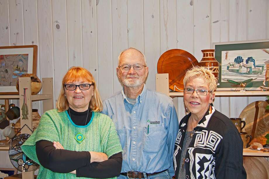The Cove, an art store located in Port Austin, will have a grand re-opening Friday with partners, from left, Laurie Conger, Dave Thuemmel, and Lynne Wiencek on hand to answer questions about the store. Photo: Bill Diller/For The Tribune