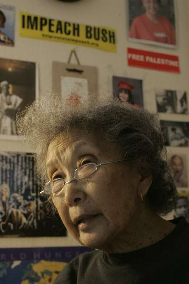 Above: Yuri Kochiyama, social and political activist, in 2005. Left: Cesar Cueva and Corinne Cueva post to the exhibition's resistance wall.