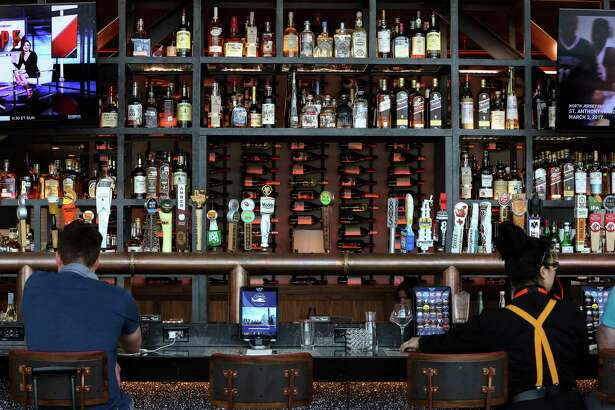 The bar of Ember, with a menu from chef Chris Shepherd of Underbelly, is among the new Houston-flavored restaurants in the new Terminal C-North at George Bush Intercontinental Airport.