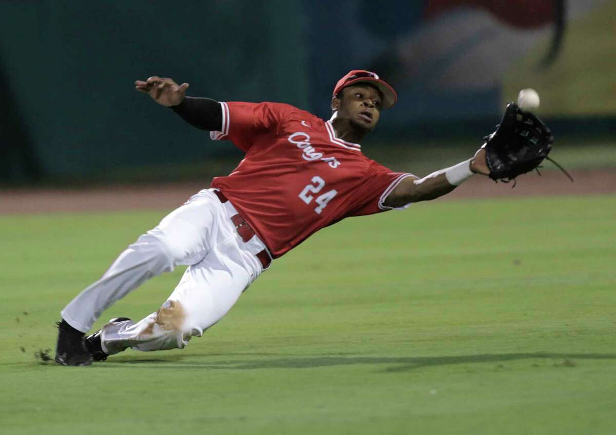 Houston infielder Corey Julks (24) holds onto a hit by Rice in the eighth inning. Photos of Houston and Rice University baseball game at Constellation Field on Tuesday, May 9, 2017, in Sugar Land. ( Elizabeth Conley / Houston Chronicle )