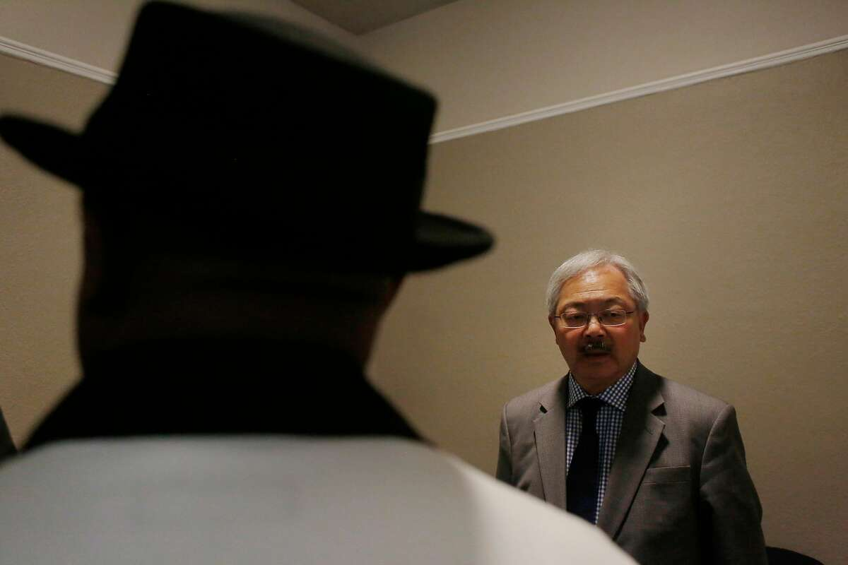 Mayor Ed Lee (right) tours a unit at the Winton Hotel after speaking at a press conference announcing new permanent supportive housing units for chronically homeless and veterans on Wednesday, May 17, 2017 in San Francisco, Calif. The Winton has been in operation since last fall.