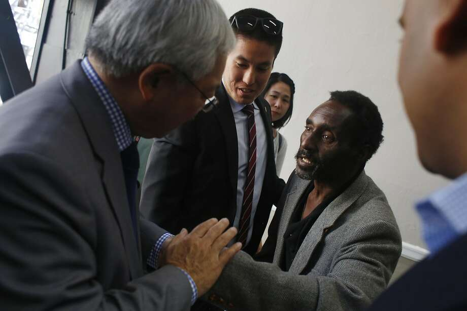 Morris Sirmans (right) thanks Mayor Ed Lee (left) at the Winton Hotel where Sirmans is one of the formerly homeless who has a new home in the hotel's supportive housing. Photo: Lea Suzuki, The Chronicle