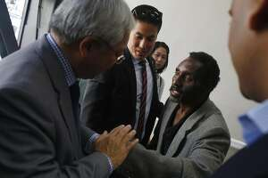 Morris Sirmans (right) thanks Mayor Ed Lee (left) after Lee spoke at a press conference  at the Winton Hotel announcing a new permanent supportive housing site at the National Hotel on Wednesday, May 17, 2017 in San Francisco, Calif. Sirmans said he is formerly homeless and moved into his new home at the Winton, which has been in operation since the fall, 4 months ago.