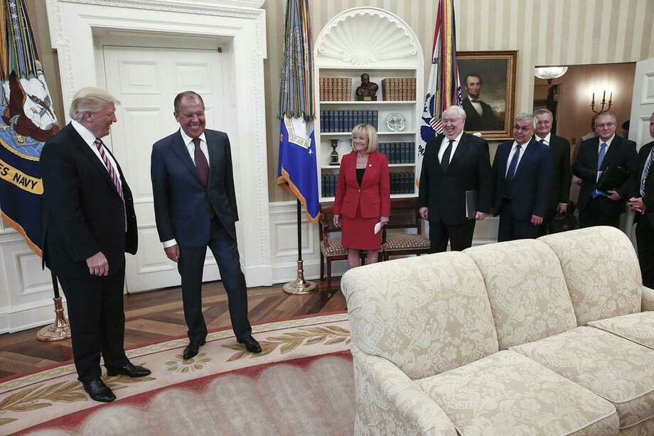 This handout photo was made available by the Russian Foreign Ministry on May 10. The U.S. press was barred from the meeting. It shows President Donald J. Trump and Russian Foreign Minister Sergei Lavrov, second to the left, during a meeting at the White House. At the meeting the president gave classified information to the Russians that he shouldn't have. Photo: HO /AFP /Getty Images / Stratford Booster Club