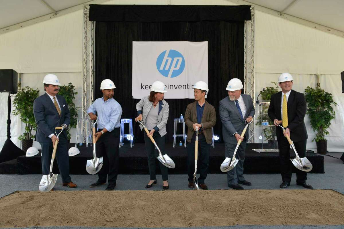"""IMAGE DISTRIBUTED FOR HP - Dean Patrinely, Charles Jones, Cynthia Rock, Alex Cho, Greg Shoemaker, and Jon Flaxman dig in to celebrate the formal groundbreaking for the future site of the HP Houston Campus at the HP Houston Campus Groundbreaking Ceremony on Tuesday, May 16, 2017, in Spring, Texas. The new campus is being hailed as """"The Office of the Future"""" and a major milestone for HP. (Anthony Rathbun/AP Images for HP)"""