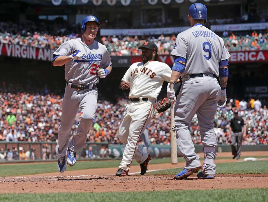 Dodgers' Chase Utley, scores from 3rd base on a wild pitch in the third inning, as the San Francisco Giants take on the Los Angeles Dodgers in MLB action at AT&T Park in San Francisco, Ca. on Wednesday May 17, 2017. Photo: Michael Macor, The Chronicle