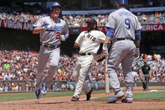 Dodgers' Chase Utley, scores from 3rd base on a wild pitch in the third inning, as the San Francisco Giants take on the Los Angeles Dodgers in MLB action at AT&T Park in San Francisco, Ca. on Wednesday May 17, 2017.