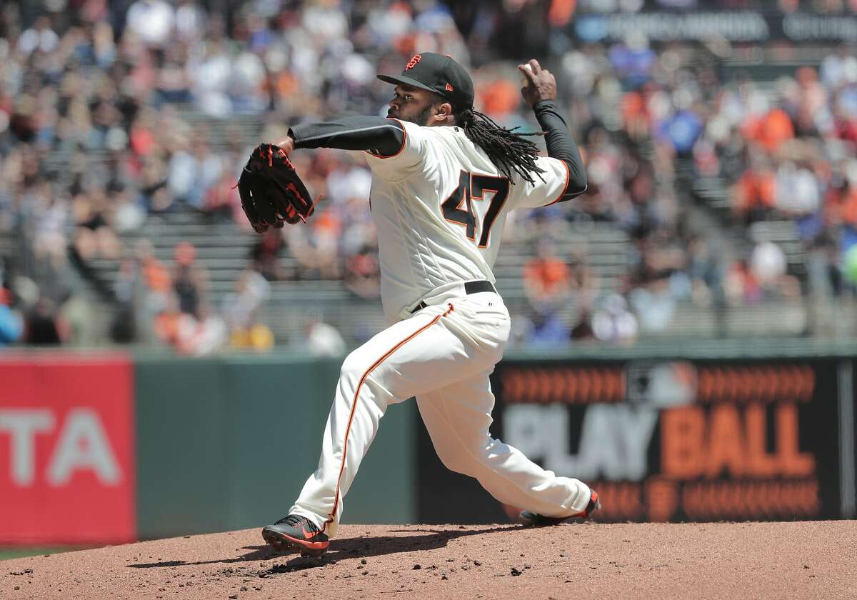 Giants' starting pitcher Johnny Cueto throws, as the San Francisco Giants take on the Los Angeles Dodgers in MLB action at AT&T Park in San Francisco, Ca. on Wednesday May 17, 2017.