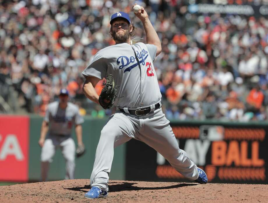Dodgers' starter Clayton Kershaw held the Giants to three singles in seven innings to prevent a sweep by San Francisco. Photo: Michael Macor, The Chronicle
