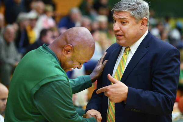 Former Siena star, now head coach for New Jersey City University, Marc Brown, left, and Siena head coach Jimmy Patsos before the start of an exhibition game at Siena's Alumni Recreation Center Saturday Nov. 2, 2013,in Colonie, NY.   (John Carl D'Annibale / Times Union)