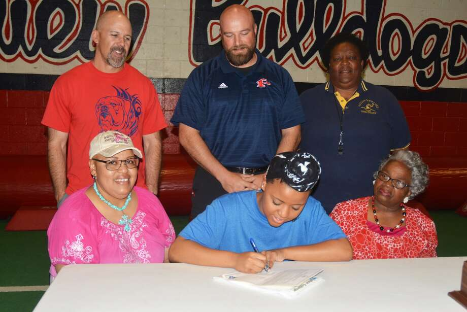 Plainview High School senior Mya Davis, seated center, signs a letter of intent to compete in track at Tabor College in Kansas. She will throw the discus and shot put. Looking on, seated, are her mom Glenda Davis, left, and her grandmother Laverne Shannon, right. Standing, from left, are Plainview High track head coach Lee Walker, Plainview track throws coach Jodie LaFrance, and Plainview track girls coordinator Della Riggins. Photo: Skip Leon/Plainview Herald