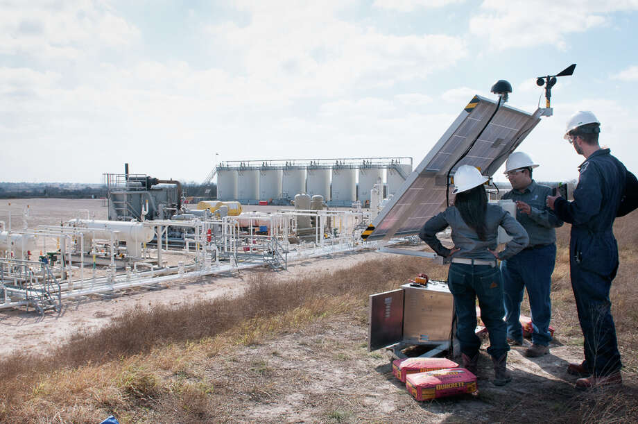 Andrea Machado Miguens and Desikan Sundararajan, both senior researchers in Statoil's shale oil and gas team, with Dirk Richter, founder of Quanta3, as Quanta3's solar powered methane detection system is installed in in Karnes County in the Eagle Ford Shale in South Texas. The detection system is part of the Methane Detectors Challenge, a partnership of oil and gas companies and the Environmental Defense Fund to come up with a remote monitoring system that can catch methane leaks. Photo: Environmental Defense Fund, Photographer / Copyright © John Davidson. All Rights Reserved
