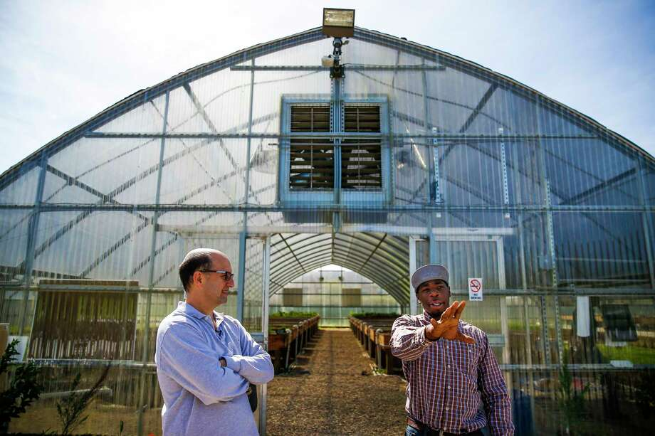 Former Houston Rockets head coach and Pro-Vision Charter School board member Jeff Van Gundy, left, talks about the school's aquaponic greenhouse with head farmer Jeremy Peaches, right, during a tour of the school Thursday, March 2, 2017 in Houston. Photo: Michael Ciaglo, Houston Chronicle / Michael Ciaglo
