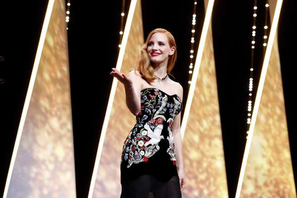 Jury member Jessica Chastain arrives on stage during the opening ceremony of the 70th international film festival, Cannes, southern France, Wednesday, May 17, 2017. (AP Photo/Thibault Camus)