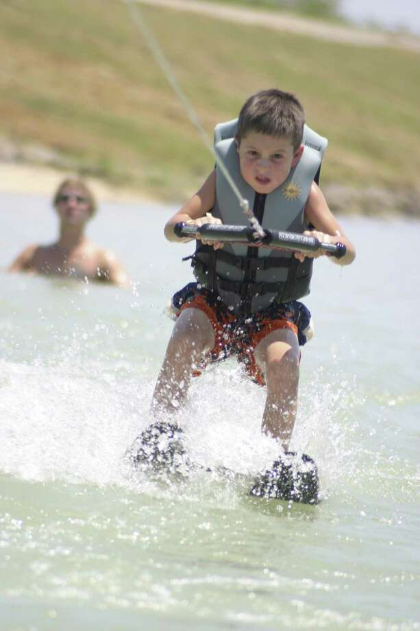 "A Texas Ski Ranch camper learns to waterski during a summer program. The 70-acre park also offers cable system wakeboarding, ""snow"" boarding, and a skate and trampoline park. Photo: Courtesy Texas Ski Ranch"