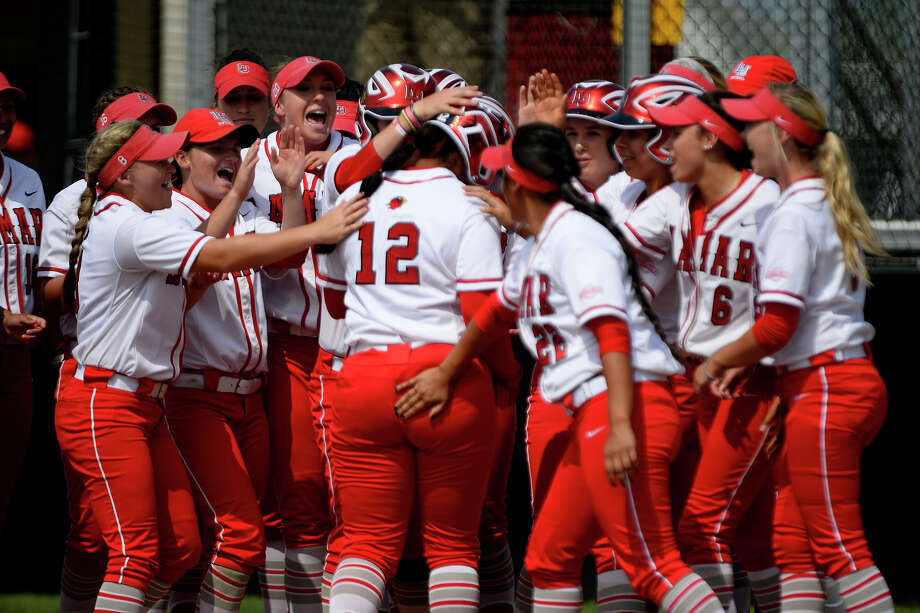 Lamar players celebrate a three-run home run by Sable Hankins (12) against Abilene Christian in the National Invitational Softball Championship at the Lamar softball complex on Wednesday afternoon.  Photo taken Wednesday 5/17/17 Ryan Pelham/The Enterprise Photo: Ryan Pelham / ©2017 The Beaumont Enterprise/Ryan Pelham